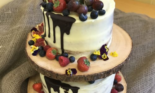 Semi Naked Wedding Cake, dressed with summer berries